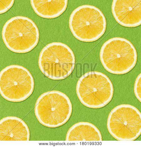 yellow lemon slices on green Background Close-up Studio Photography