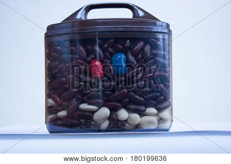 On the background are unique beans in a jar.