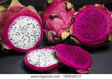 Red and White Dragon Fruit Sliced on a Cutting Board