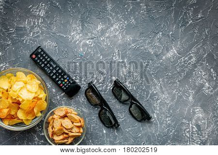 watching movies concept with chips on dark table background top view mock up