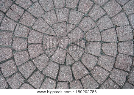 Cobbles Of Red Granite In The Form Of A Circle. The Texture Of Granite.