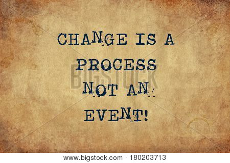 Inspiring motivation quote with typewriter text Change is a process not an event. Distressed Old Paper with Typing image.