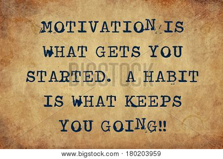Inspiring motivation quote with typewriter text Motivation is what gets you started a habit is what keeps you going. Distressed Old Paper with Typing image.