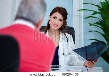 Doctor examining a radiography with her patient