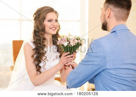 Happy wedding couple at home