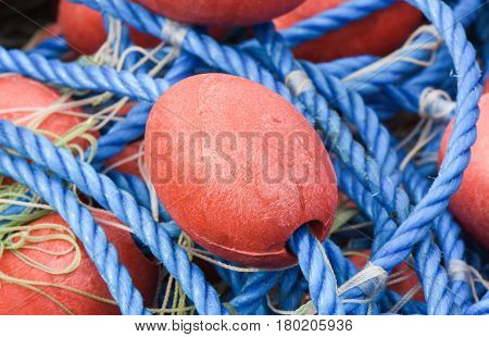 Fishing nets closeup with red and blue colours.