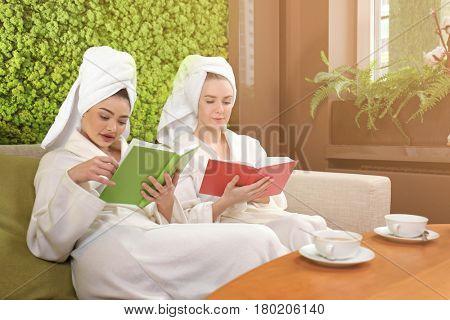 Beautiful young women resting in spa salon