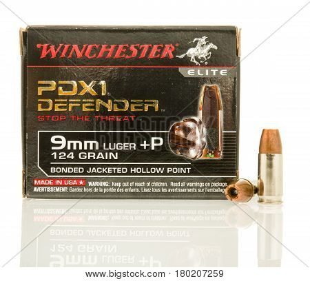 Winneconne WI - 5 April 2017: A box of Winchester PDX1 Defender 9mm hollow point bullets on an isolated background.
