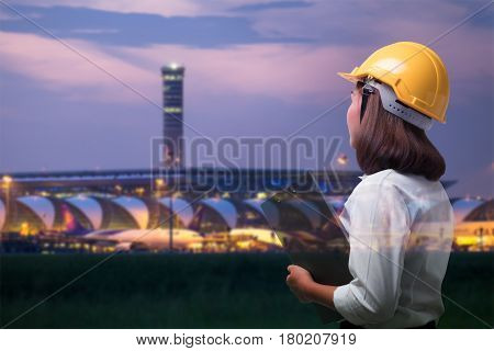 Double exposure of business woman in Airport construction site