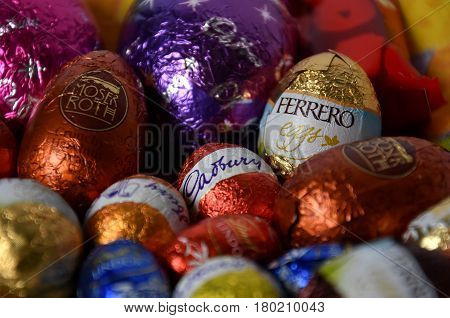 Sydney Australia - April 2 2017. Different type of chocolate eggs and bunnies from chocolate factories. Products of Ferrero Cadburry Lindt and Moser Roth are fulfilled with chocolate creme.