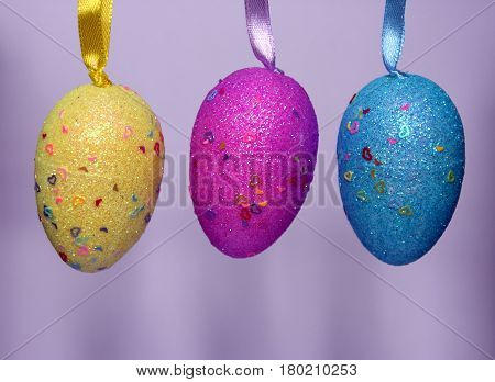 Colourful panted plastic easter eggs with sparkling dots in a row. Easter (Paschal) eggs are decorated eggs that are usually used as gifts on the occasion of Easter or springtime celebration.