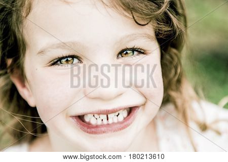 Beautiful happy young girl on a swing on holidays