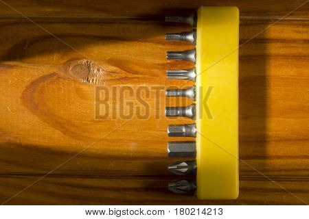 Set of screwdriver bits on a wooden background