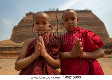 Myanmar Two little monks pay respect faith of Buddhism In Myanmar. Little monks in Mingun Pagoda Mandalay Myanmar.