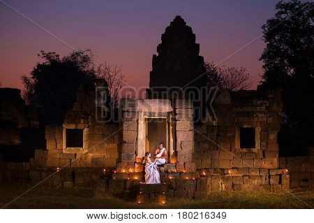 Priest or Yogi and Woman priest are Religious ceremony in Ancient Pagada made of stone or archaeological sites.