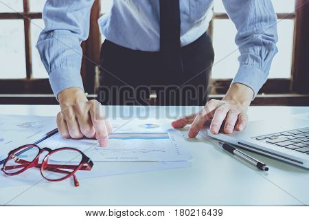 Businessman hand working with new modern computer and business strategy as concept.Business analysis and strategy concept.Close up