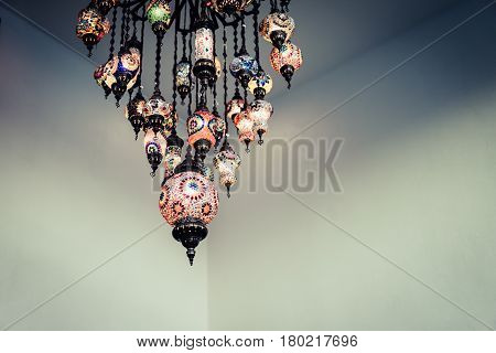 Colorful lanterns hung from the ceiling Hotel in dark vintage tone.