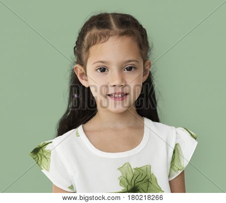 Young little girl with awkward smile expression portrait