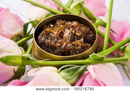 Gulkand, also known as Gulqand, is a sweet preserve of rose petals popular in India, usually used in chewing paan masala.