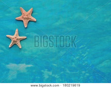 Textiles turquoise sea background with yellow sea stars