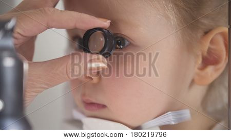 Optometrist checking little child's vision - macro shot, close up