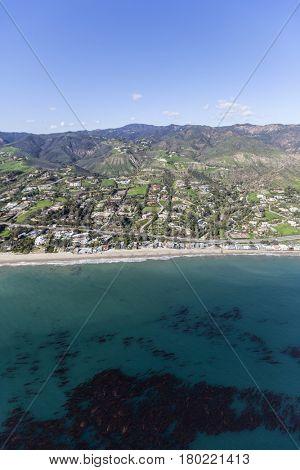 Aerial view of mountains, beaches and ocean kelp near Malibu, California.