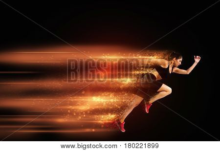 Athletic woman runner fast in sportswear with colourful trails lights on background