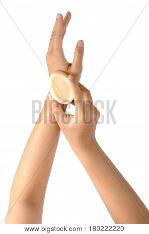 Hygiene and health care topic of woman's hands holding soap isolated on white background clipping path.