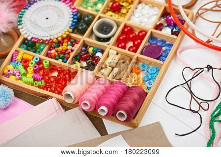 set of accessories and jewelry to embroidery, haberdashery, sewing accessories top view, seamstress workplace, many object for needlework, handmade and handicraft