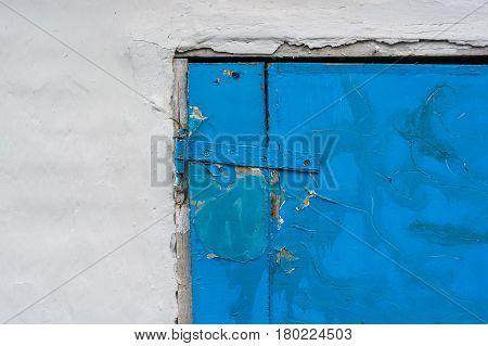 Close-up old door hinge on wooden door