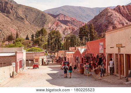 Purmamarca Argentina - November 1 2016: Street with souvenir shops and tourists in Purmamarca
