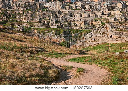 Matera, Basilicata, Italy: landscape at sunrise of the old town (sassi di Matera), view from the park of the rock churches, with the houses carved into the tufa rock over the deep ravine
