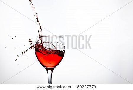 One glass with pink wine and sprays