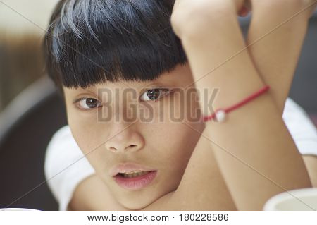 Close Up Shot Of Handsome Asian Boy Relaxing