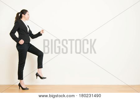 Young Businesswoman Walking Up On Steps Of Career