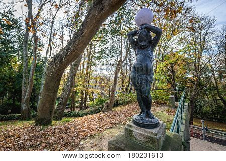 Sculpture with lantern in Crystal Palace Gardens public park in Porto Portugal