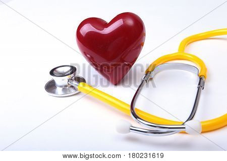 Medical stethoscope and red heart isolated on white background