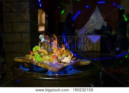 roast ribs meats with fire. Ham flambe