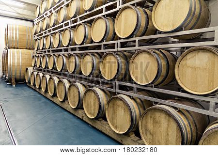 Traditional old wooden barrels are used in top wine cellars or home basements for storing different kinds of beverages like wine whiskey or rum cider represent a lifestyle with vintage spirit making  wood everlasting. Casks are hollow cylindrical containe