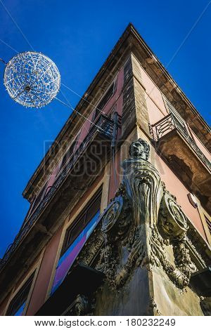 Statue on a apartment house in Porto city Portugal