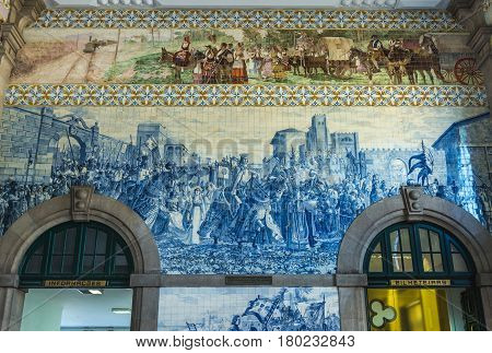 Blue tiles decoration of Sao Bento railway station in Porto city in Portugal