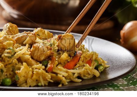 Fried Rice Nasi Goreng With Chicken And Vegetables On A Plate