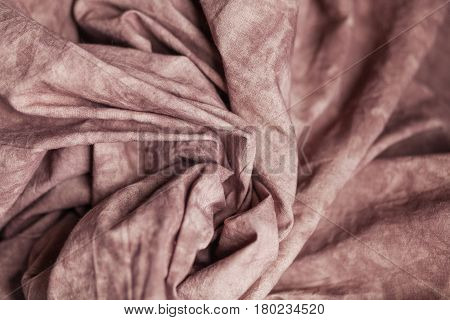 Coffee color checked fabric as a background. Bokeh, fashion, clothes, textured background, sewing industry, cosy and home concept.