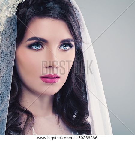 Nice Bride. Beautiful Young Woman Fiancee with Permed Hair Makeup and Veil