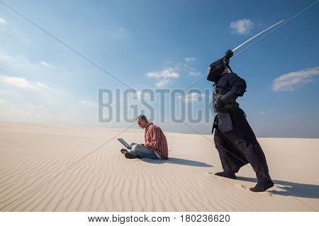 Man With Laptop Above Him Is A Samurai With A Sword, As An Deadline Symbol
