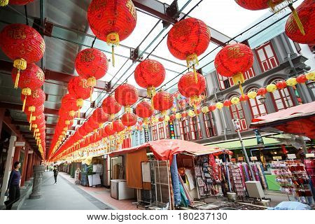 CHINATOWN SINGAPORE - JANUARY 20 2017: Chinatown street in Singapore Chinatown district beautiful fully ornate crowded Chinese lantern.