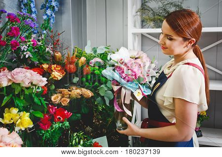 atractive young girl working in a flower shop