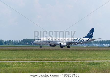 SCHIPHOL NETHERLANDS - JUNE 4 2016: A KLM Skyteam plane takes off at amsterdam international airport. SkyTeam is an alliance between different global airlines