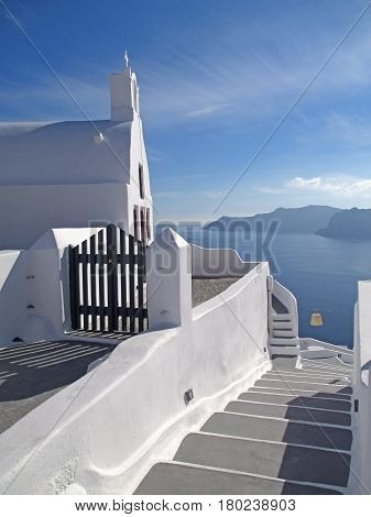 Greek Islands Style White Architecture with Blue Sea and sky at Santorini Island, Greece