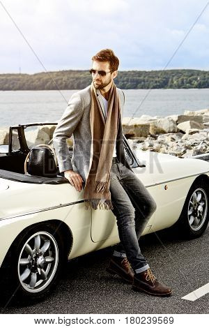 Sports car dude in scarf looking away